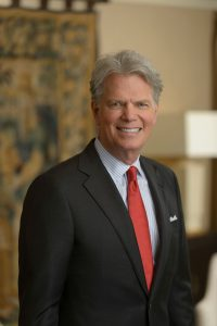 professional photo of certified financial planner Stewart Welch wearing black suit and red tie